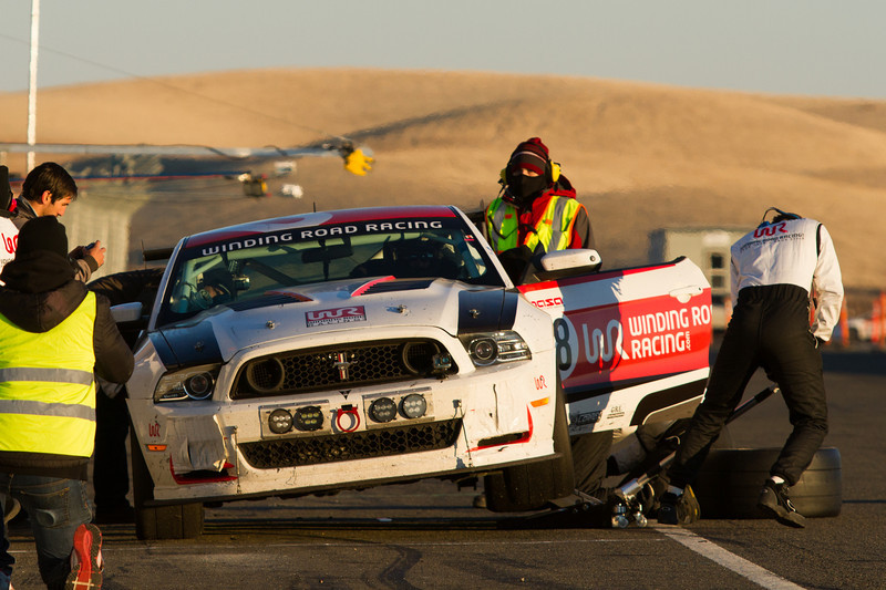 Mustang in for tire change in the final hours of the race. Still running strong and on its way to win the E0 class.