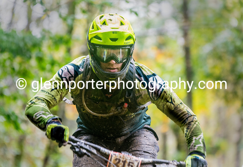A muddy mountain biker, at Cwmcarn.