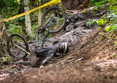 Sebastian Halpern-Reiss (USA) takes a spill while racing in the Men's Open Class Downhill Final of the US Open of MTB Downhill held in Killington, Vermont. August 4, 2018.