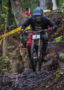 Kiran Mackinnon (USA) racing in the Men's Open Class Downhill Final of the US Open of MTB Downhill held in Killington, Vermont. August 4, 2018.