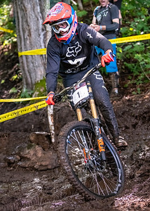 Neko Mulally (USA) racing to victory in the Men's Open Class Downhill Final of the US Open of MTB Downhill held in Killington, Vermont. August 4, 2018. He ended up with a winning time of 4 min 54.7 seconds down the brand new 2.75 kilometer course off the top of Killington's K1 peak.