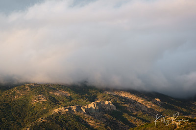 Clouds rolling across the mountains after a storm.