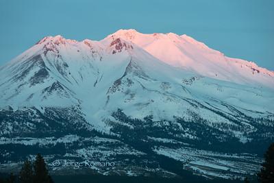 Sunset light on top of Mount Shasta in Winter