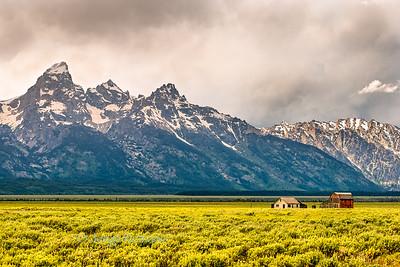 Historic Mormon Ranch and Grand Teton Mountains early morning, Wyoming, USA.