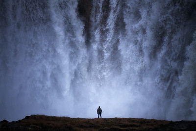 Spending a moment in the wake of heavy mist at the foot of this monstrous falls in the State of Idaho.  2019