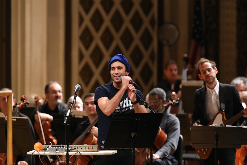 "Singer-songwriter Sufjan Stevens, Nico Muhly and Bryce Dessner peforme selections of ""Planetarium"" with the Cincinnati Symphony Orchestra during the fourth night of the MusicNOW Festival at Music Hall on Saturday, March 14, 2015. Emily Maxwell 