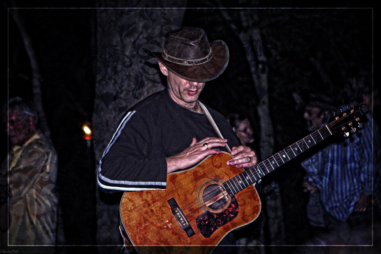 David True- .- Vocals/Guitarist/Songwriter <br /> David True on guitar at a South Austin shindig.