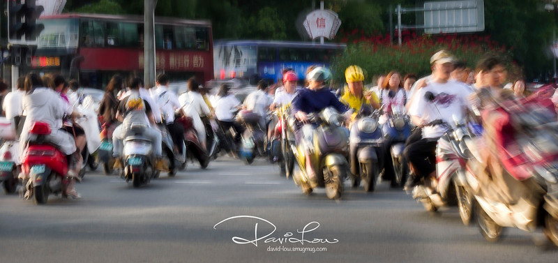 Guilin city - Most motorcyclists possess the finesse of weaving around each other that hardly cause any accident!