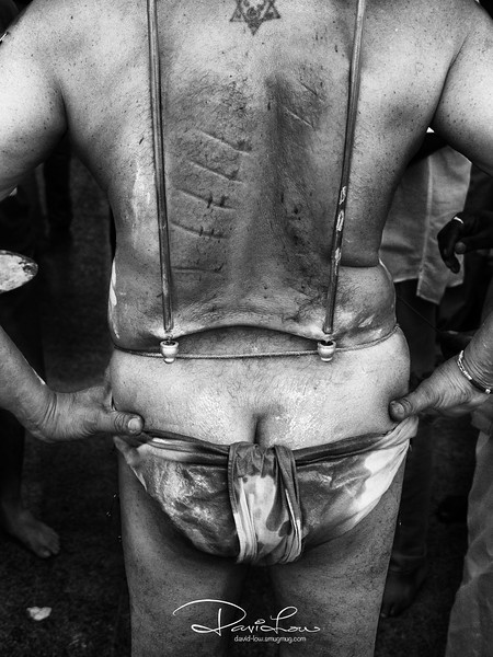 The battled body of a Thaipusam devotee - after the 4km walk with the kavadi