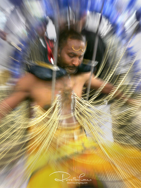 A Thaipusam devotee dancing around. Such festive occasion gave me the chance to use a slow shutter speed and zooming of the lens to intensify the power of the action.