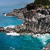 Jejudo Coastline<br /> The Jusangjeolli Cliff. Shot on Jeju Island, South Korea, where 6-sided columns of lava rock rise out of aqua blue water along the Jungman-Daepo Coast. Jeju Island is a honeymoon destination in Asia.