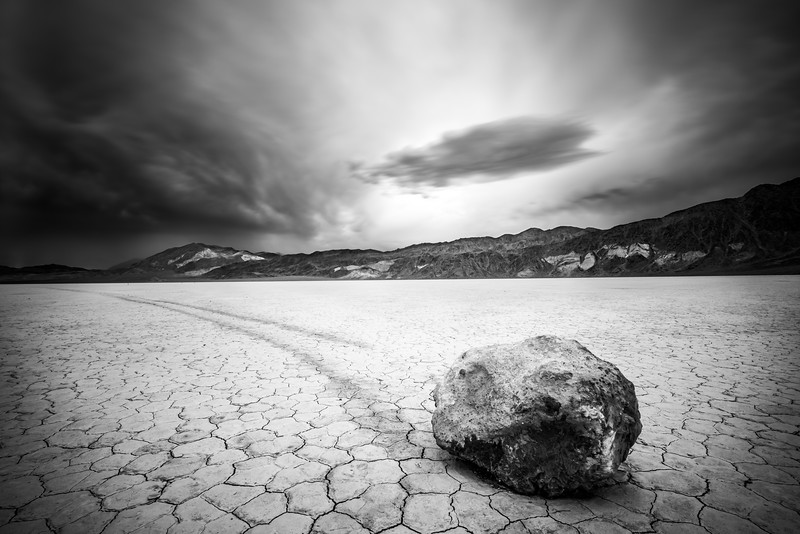Thunderstrom clouds over a sliding rock in The Racetrack Playa, Death Valley