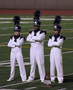 UIL Marching Contest at the SAC, 10/13/12, where they received a Superior (1) rating.  After the Awards presentation, the Drum Majors, listen to the others awards being presented.  From Left to Right Melissa Mitchell Elvis Mosquera Danielle Chesak