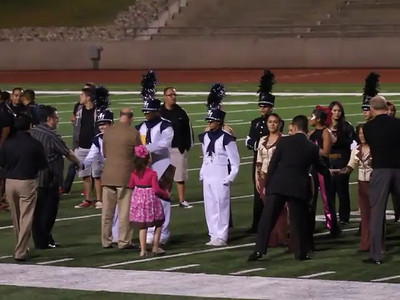 Drum Majors Saluting, after the announcement of their First Division rating.    From Left to Right Melissa Mitchell Elvis Mosquera Danielle Chesak
