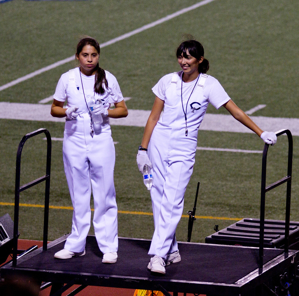 From L to R, Celeste Carmen, Danielle Chesak, preparing to lead the band in the stands, during  Coronado High School football game