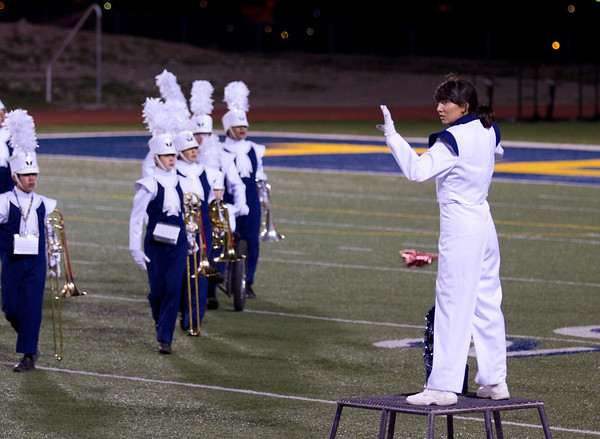 Drum Major Danielle (Dano) Chesak conducting the band at a halftime show at Coronado High School - 2013