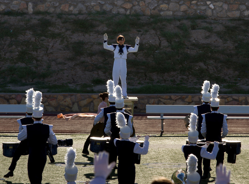 Danielle Chesak conducting the band in the back-field at the EPISD Invitational Marching contest.