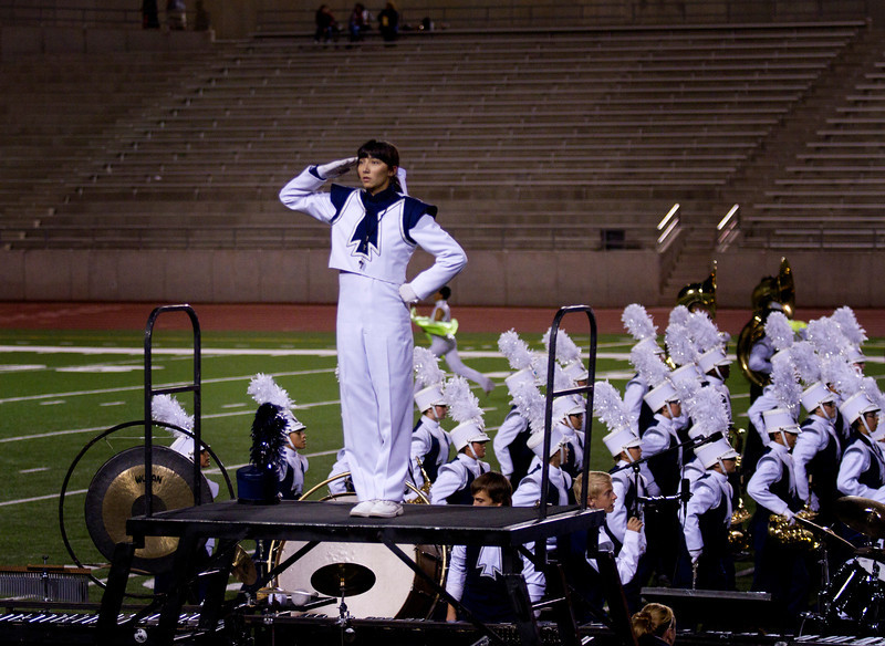 Drum Major Danielle Chesak, Saluting from Center Podium, after finishing their marching show at the UIL Marching Contest , at the Socorro SAC, where the band received a 1 (Superior Rating)