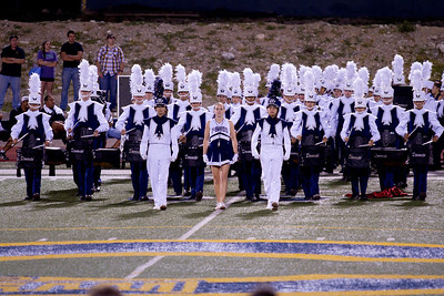 From L to R, Danielle Chesak, Melissa Mitchell, Celeste Carmen.  Drum Majors leading the band on the field at a half-time shot at Coronado High School