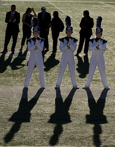 From L to R, Melissa Mitchell, Danielle Chesak, Celeste Carmen.  Drum Majors at the 2013 EPISD Invitational Marching Contest where the band received a 1 (Superior Rating).  Band Director Mark Saenz is standing behind and to the right of Danielle Chesak.  They are awaiting announcement of the results.