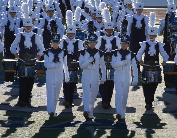 From L to R, Melissa Mitchell, Danielle Chesak, Celeste Carmen.  Drum Majors leading the band onto the field at the EPISD Invitational Marching Contest where the band received a 1 (Superior Rating)