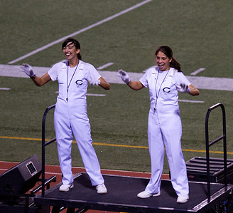 From L to R, Danielle Chesak, Celeste Carmen Having a good time while leading the band during Coronado High School football game
