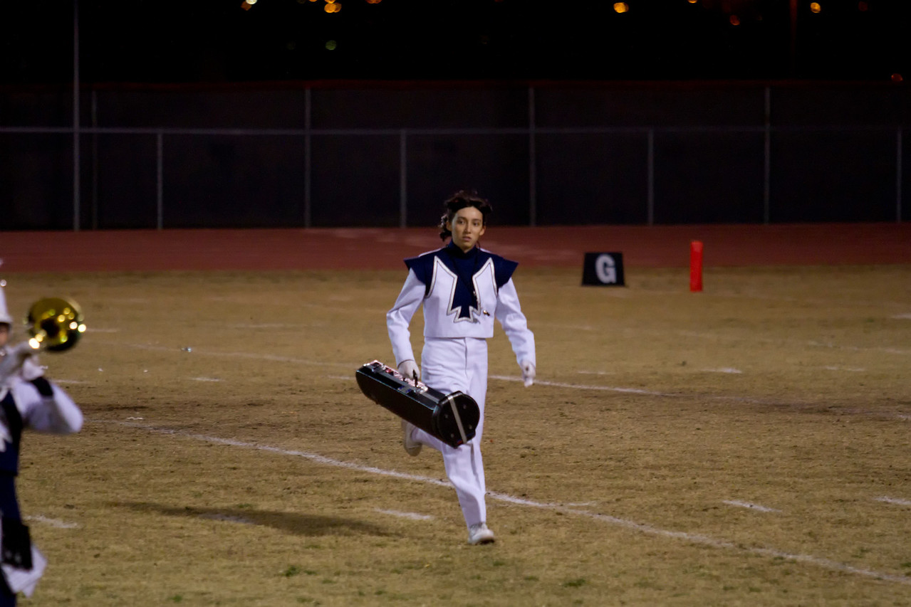 Danielle Chesak, Drum Major for Coronado High School running across the field in preparation for her Tormbone Solo, at the Bel Air / Coronado half-time show