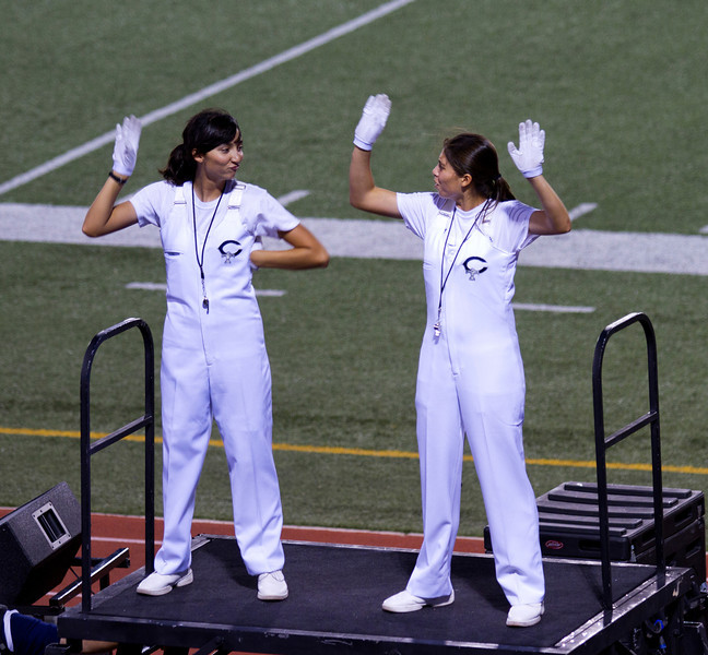 From L to R, Danielle Chesak, Celeste Carmen hamming it up while leading the band during Coronado High School football game