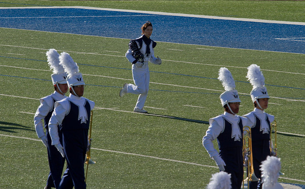 Danielle Chesak dashing across the field after conducting on the back-field, at the 2013 EPISD Invitational Marching Contest.