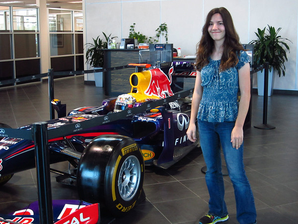 Formula 1 Team Red Bull visiting the Local Infinity dealership in Austin.  Jordan posing in front of the car.  Photo by Jord