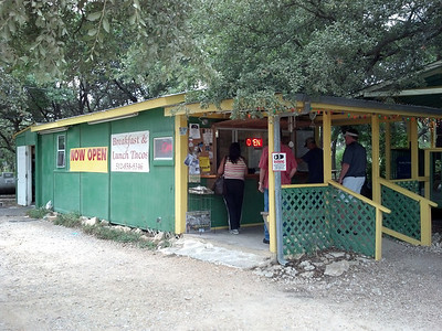 Michelle buying a couple egg burritos in a small but popular stand in Dripping Springs.