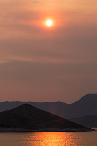 Sunset in forest fire smoke