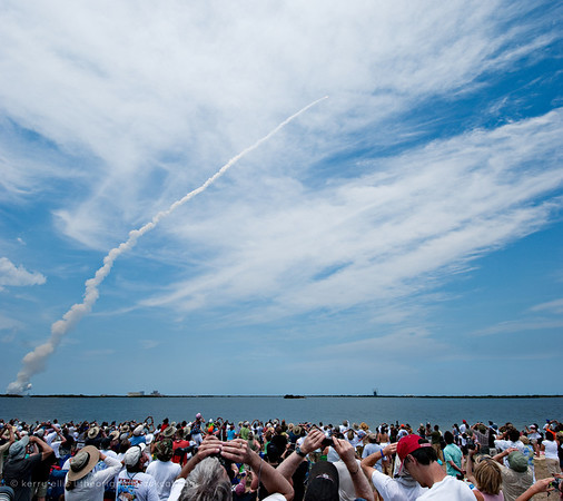 The crowd watches as NASA Space Shuttle Atlantis, STS-125, launches May 11, 2009, for the Hubble servicing mission.