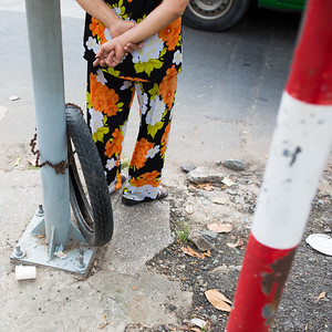 Bike Chain, Tire, and Floral Outfit | Ho Chi Minh City, Vietnam