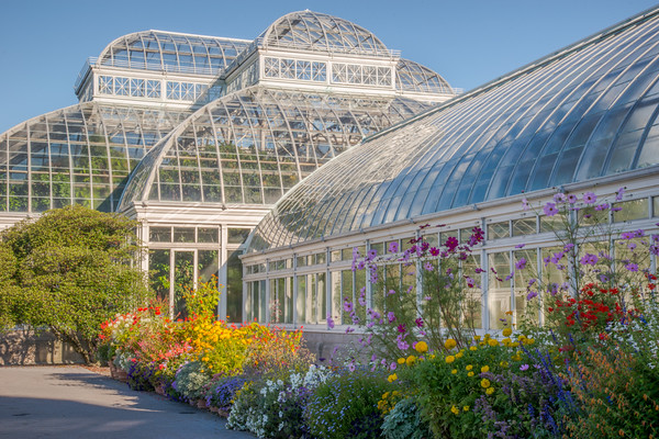 page 83, Thousands of colorful annuals and perennials spill into the Conservatory Courtyards during the summer months.