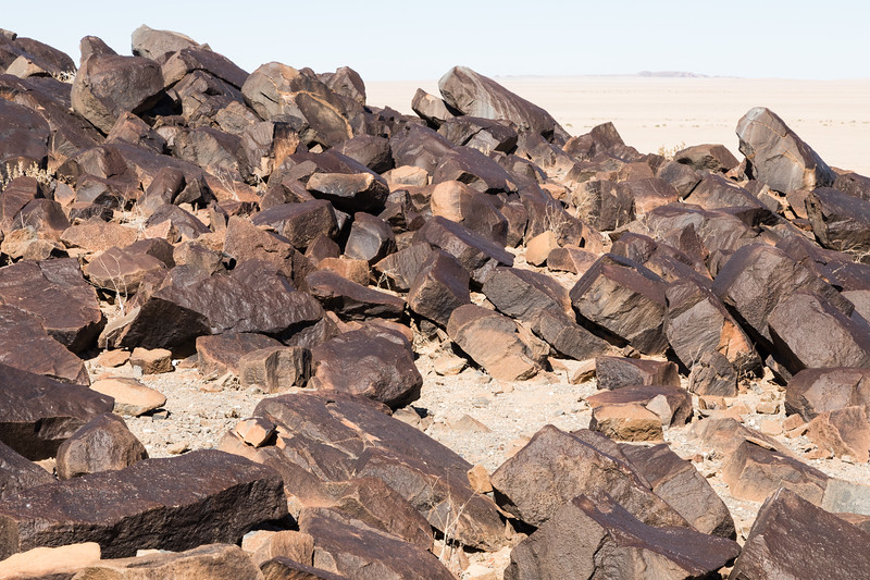Close up of rocks - wide desert in the background