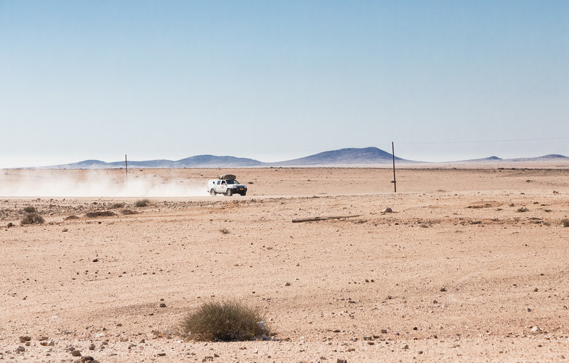 Lone vehicle in the vast landscape