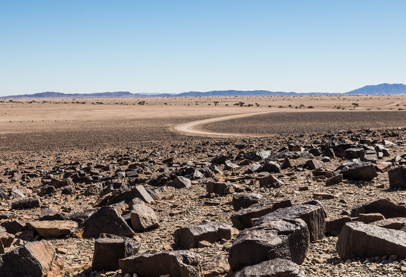 Vast Namibian landscape with large rocks in the foregound