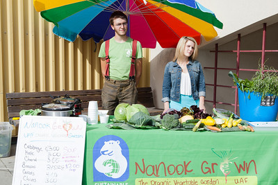 Students Alexander Bergman, left, and Katie Luper, sell a variety of organic vegetables grown on campus to students, faculty, and community members Thursday, August 23, 2012 in front of the Wood Center. Sustainable UAF will continue to sell vegetables until the weather gets too cold.  Filename: LIF-12-3499-11.jpg