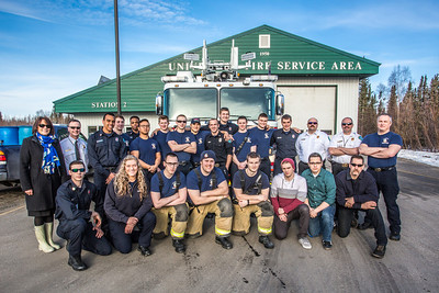 Members of the University Fire Department pose for a photo in front of the newest fire engine in the fleet at the South University Avenue station April 18.  Filename: LIF-14-4152-18.jpg