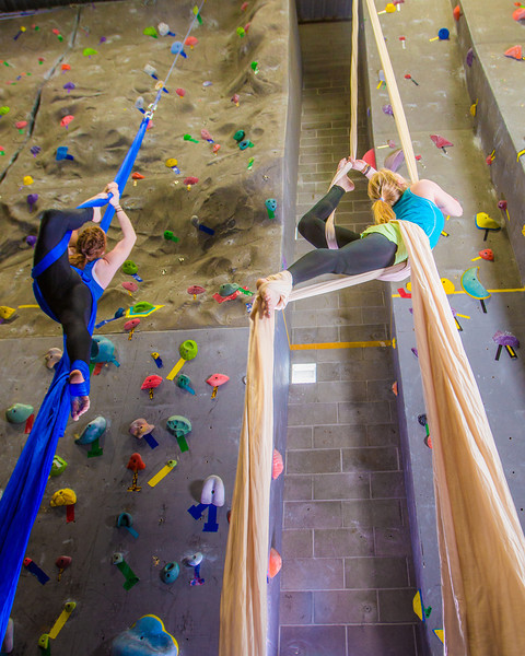 """Undergraduates Miriam Brooks, left, and Teal Rogers practice their silk climbing skills in the SRC.  <div class=""""ss-paypal-button"""">Filename: LIF-13-3819-131.jpg</div><div class=""""ss-paypal-button-end"""" style=""""""""></div>"""