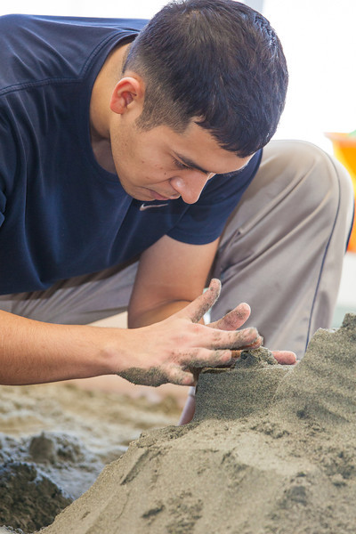 """Luis Arauz participated in a promotional sand castle building competition during the spring semester in the Lola Tilly Commons.  <div class=""""ss-paypal-button"""">Filename: LIF-12-3329-42.jpg</div><div class=""""ss-paypal-button-end"""" style=""""""""></div>"""