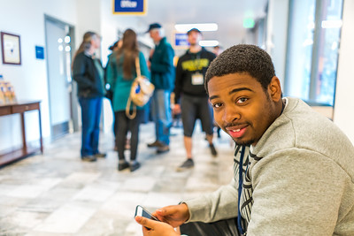 Returning students, staff and parents all pitch in to help new arrivals move into the residence halls during Rev It Up on the Fairbanks campus at the beginning of the fall 2015 semester.  Filename: LIF-15-4637-94.jpg