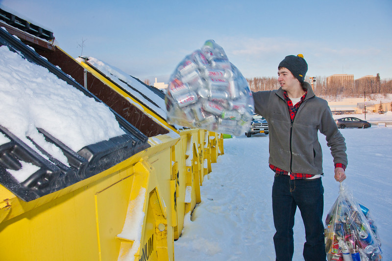 "Brandon Hoover loads aluminum cans from the MBS residence hall complex into the campus recycle bins.  <div class=""ss-paypal-button"">Filename: LIF-11-3210-04.jpg</div><div class=""ss-paypal-button-end"" style=""""></div>"