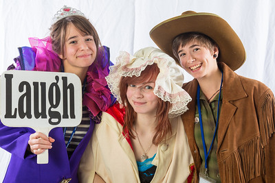 Students pose in the UAF Facebook photobooth during a back-to-school orientation party in the Wood Center.  Filename: LIF-12-3517-24.jpg