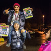 "While waiting in line, Mizani Rawhani sits on top of Christopher Baca for a photo during Fred Meyer's College Night shopping extravaganza.  <div class=""ss-paypal-button"">Filename: LIF-13-3926-3.jpg</div><div class=""ss-paypal-button-end"" style=""""></div>"