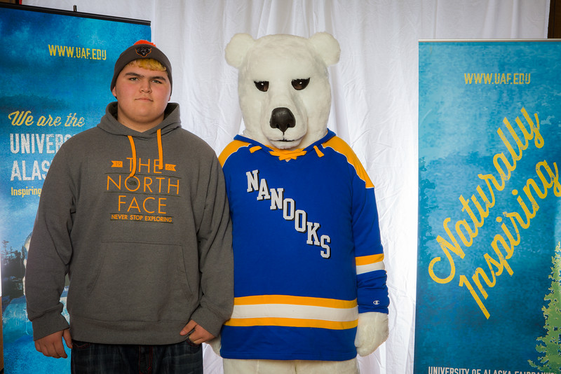 """Prospective students pose with the UAF mascot during the Fall 2015 Inside Out event hosted by UAF's office of admissions and the registrar.  <div class=""""ss-paypal-button"""">Filename: LIF-14-4353-35.jpg</div><div class=""""ss-paypal-button-end""""></div>"""