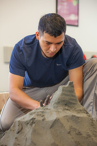 Luis Arauz participated in a promotional sand castle building competition during the spring semester in the Lola Tilly Commons.  Filename: LIF-12-3329-39.jpg