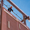 "Outdoor Adventure manager Frank Olive helps prepare the north wall of the outdoor climbing tower for a season of ice climbing.  <div class=""ss-paypal-button"">Filename: LIF-11-3237-55.jpg</div><div class=""ss-paypal-button-end"" style=""""></div>"