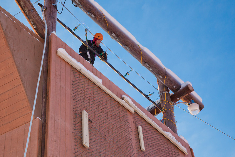 """Outdoor Adventure manager Frank Olive helps prepare the north wall of the outdoor climbing tower for a season of ice climbing.  <div class=""""ss-paypal-button"""">Filename: LIF-11-3237-55.jpg</div><div class=""""ss-paypal-button-end"""" style=""""""""></div>"""